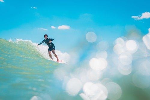 Surfer Photo by Ryan Magsino on Unsplash @rymagsino
